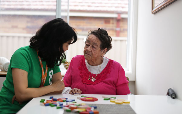 A benevolent society carer with an aged care client at home