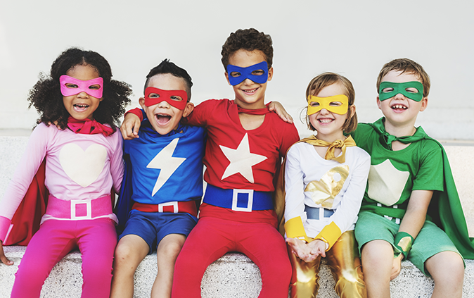 kids dressed up as super heroes