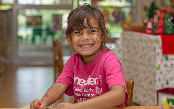 Smiling girl at Early Years Centre with a Benevolent Society T-shirt