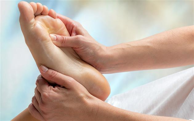 A foot receiving remedial massage