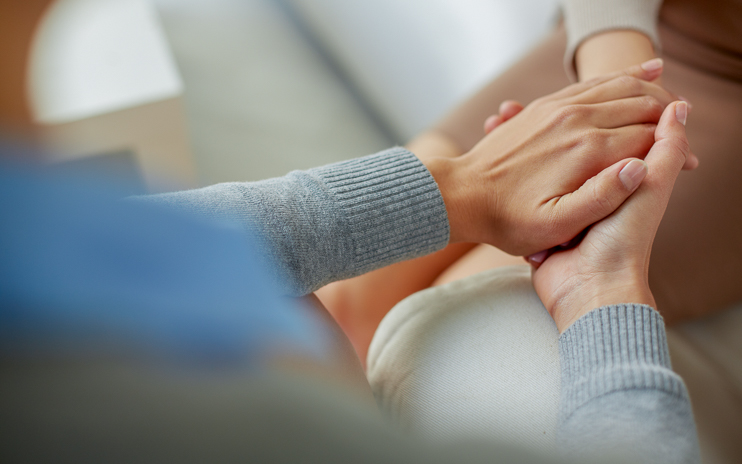 Therapist holding clients hand