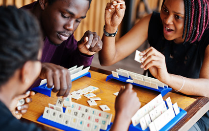 Young people playing a board game