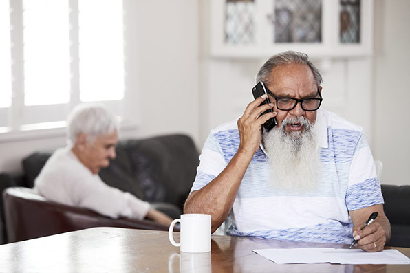 Man talking on the phone to carers gateway