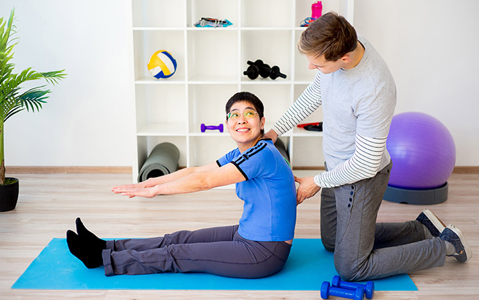 Physiotherapist helping client