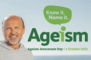 An older man at the ocean with the Ageism Awareness Day logo next to him. The slogan is written underneath saying