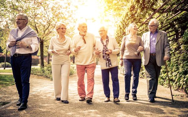 A smiling group of elders walking together