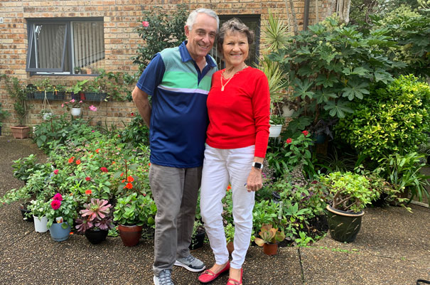 A smiling photo of Mary and Bob standing together