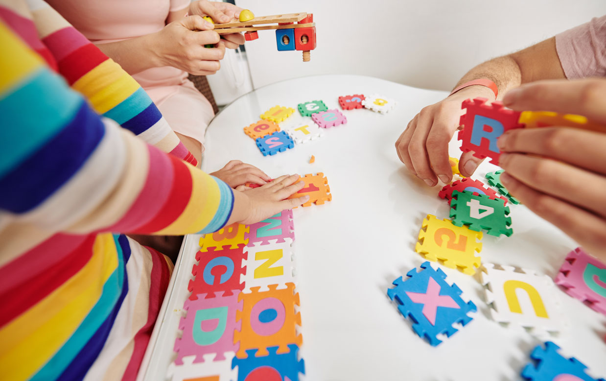 Children playing with letters of the alphabet